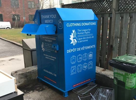 Woman dies after being trapped in clothing donation box image
